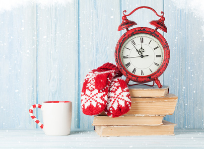 Christmas alarm clock, mittens and hot chocolate. View with copy space